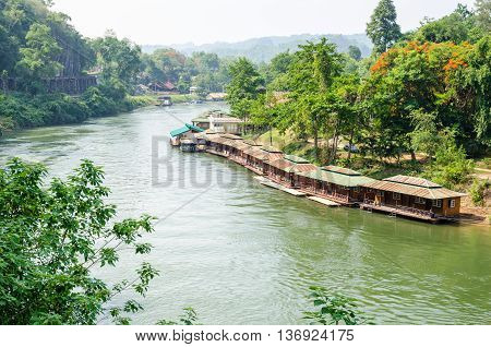 Beautiful landscape Kwai Noi river under Death Railway bridge and floating resort at Krasae cave in Kanchanaburi province Thailand