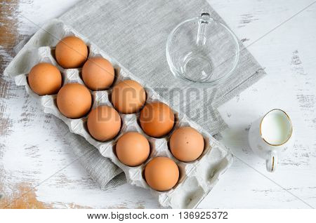 Breakfast Setting - Eggs In A Cardboard Tray And Milk In A Jug