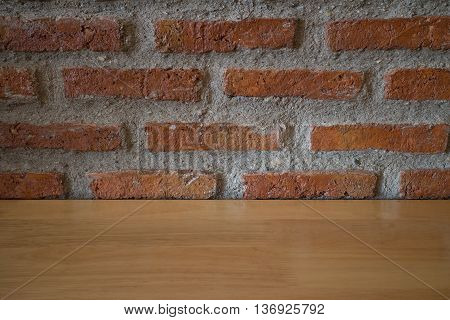 Background of old vintage brick wall with wood table.