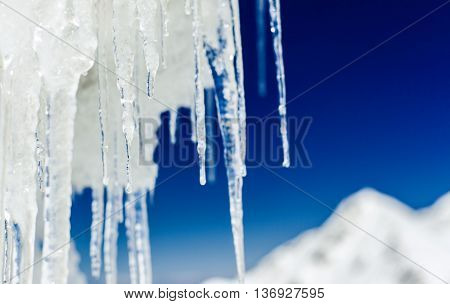 long icicles close-up with shallow depth of field