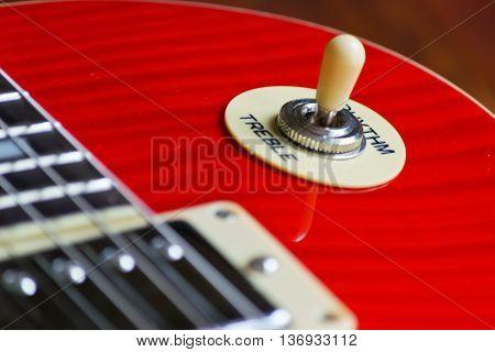 close up of an electric guitar pick up selector