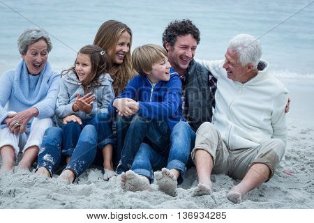 Happy family sitting at beach