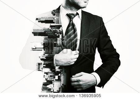 Businessman and city isolated on white background. Black and white image. Double exposure