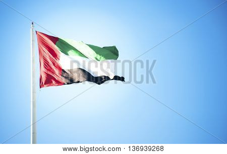 United Arab Emirates flag flying against clean and tranquil sky