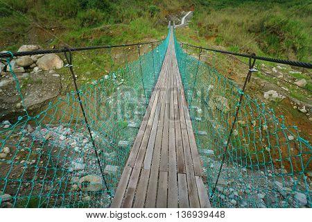 Common bridge walkway to cross river in Borneo interior