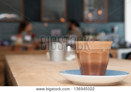 Cafe Interior Background With Fresh Coffee On The Table In The Coffee Shop