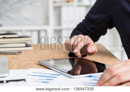 Man Using Tablet Closeup