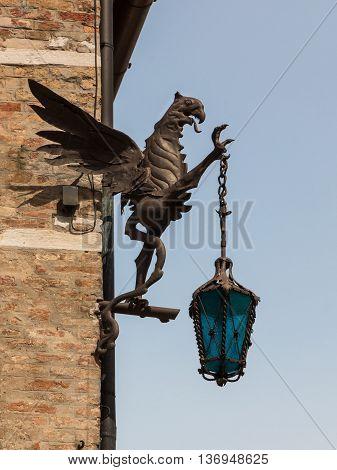 Wrought Iron Dragon With Lantern, Decoration On Brick Wall