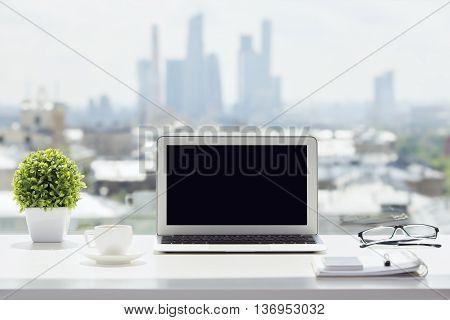 Laptop On Windowsill
