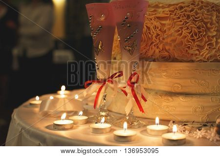 Wedding steamware with cake and candles on table