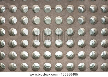 Abstract texture of a concrete roof with round glass inlets facing the sky
