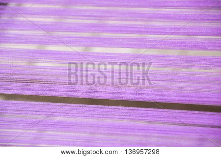 Close up Purple yarn silk on loom weaving