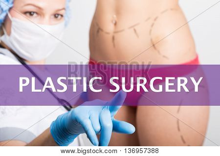 plastic surgery written on a virtual screen. Internet technologies in medicine concept. medical doctor presses a finger on a virtual screen. cosmetic surgery, lifting and breast augmentation.
