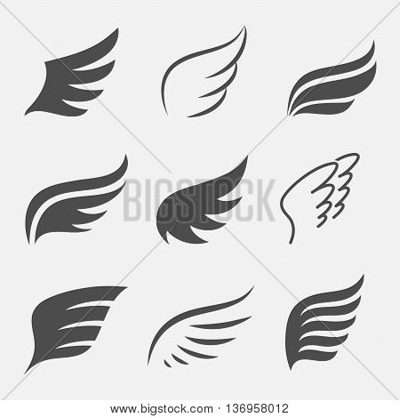 Wings vector set of icons isolated from the background. Abstract wings of a bird or angel for the logo badges and emblems. Simple silhouettes spread wings.