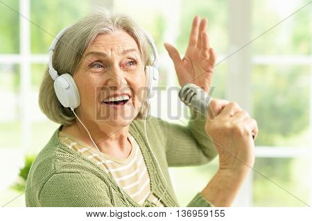Portrait of a senior singer woman close up