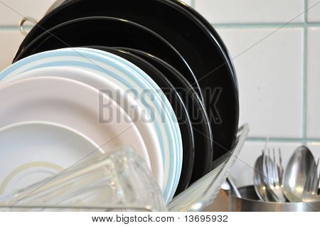 the clean dishes on the metal rack