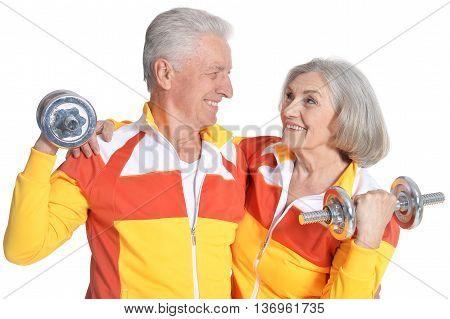 Portrait of Senior Couple Exercising On White Background