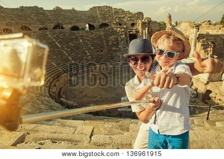 Mother with son take a vacation photo on the Side ampitheatre view