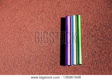 Relay baton on running track in stadium