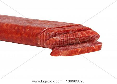 Sliced appetizing salami taken closeup isolated on white background.
