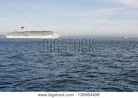 White cruise ship leaving the bar of the river Tagus