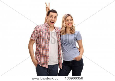 Woman pranking her boyfriend with bunny ears isolated on white background