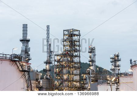 Oil Refinery And Petroleum Industry At Night Time