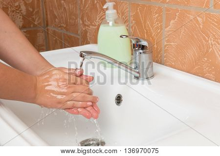 Woman Washing Hands. Cleaning Hands. Hygiene bathroom