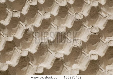 Selective focus on cardboard tray for eggs abstract image like the repeating natural background
