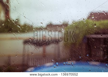 rain behind a wet window . .