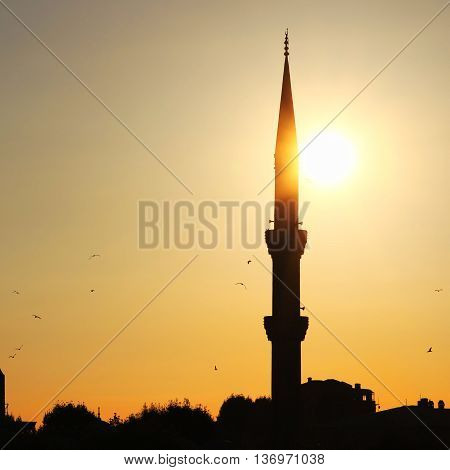 Blue mosque minaret silhouette with sunset sky,Istanbul,Turkey