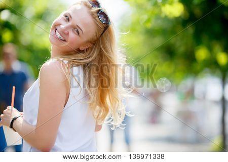 Portrait of pretty girl threw back her head