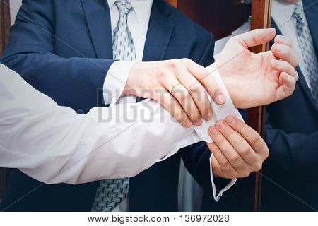 Groom prepared to get married by best man. Marriage and wedding concept image.