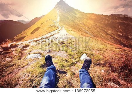 Tourism in mountains. Tourist rest on the mountain path. Nature in mountains at autumn.