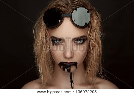 Steampunk Girl with Sunglasses and black Paint Drips from Mouth. Halloween Makeup