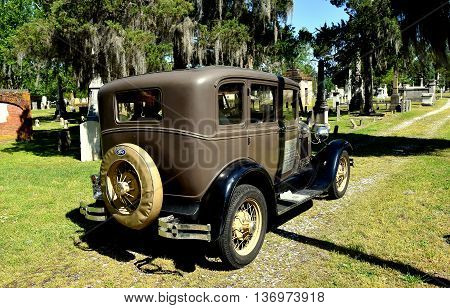 New Bern North Carolina - April 24 2016: A vintage 1929 Model A Ford sightseeing vehicle taking visitors for a tour of historic Cedar Grove Cemetery