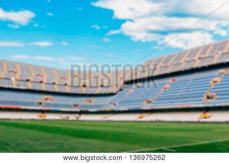 View on blurred football pitch in daylight useful as a background. Copy space area