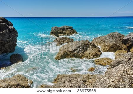 Big Rock in the blue waters of Megali Petra Beach, Lefkada, Ionian Islands, Greece