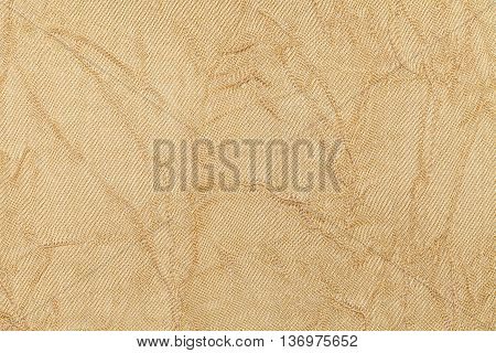 light beige wavy background from a textile material. Fabric with natural texture clousup. Upholstery fabric pleated.