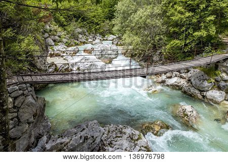 Old wooden bridge over Soca river in Slovenia