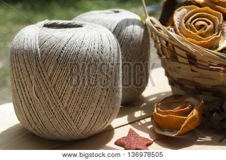 yarn for knitting in balls in the wood background