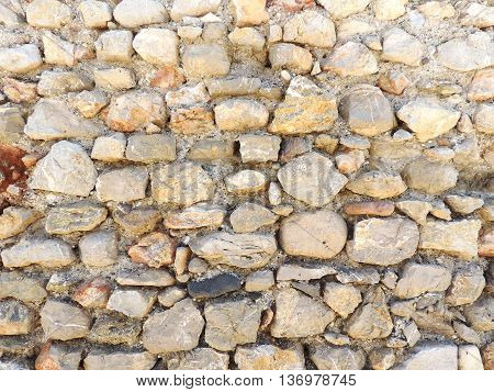 Old stonewall, close up. Ancient stone wall background or texture.