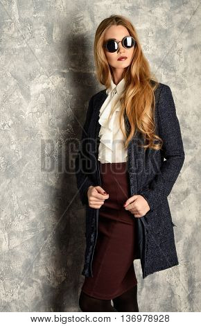 Fashion shot of the elegant young woman. Autumn, spring clothes collection.