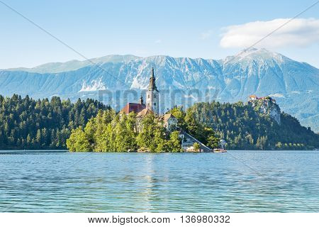 Church on an island and castle on rock in Bled lake in Slovenia