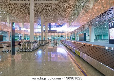 SHENZHEN, CHINA - CIRCA MAY, 2016: baggage claim area at Shenzhen Bao'an International Airport. It is located near Huangtian and Fuyong villages in Bao'an District, Shenzhen, Guangdong, China.