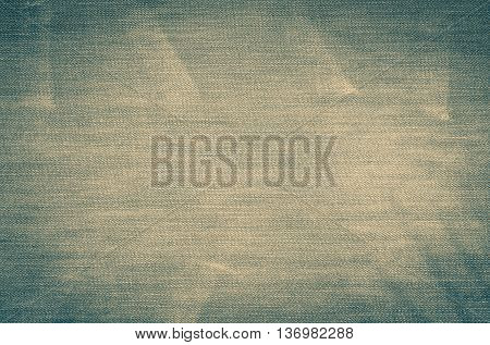 Background of denim material. The texture of jeans trousers in vintage style.