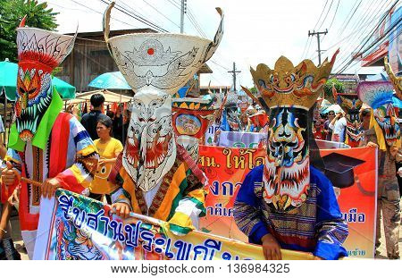 Loei province Thailand- June 28 2014: Unidentified men wear ghost costume on parade at Phi Ta Khon or Ghost Festival at Dan Sai district Loei province Thailand.