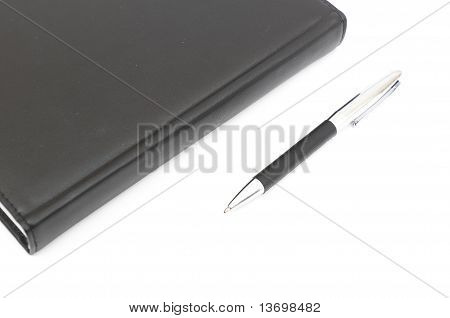 black leather Notebook and pen.