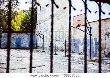 abandoned Basketball court backyard with concrete floor