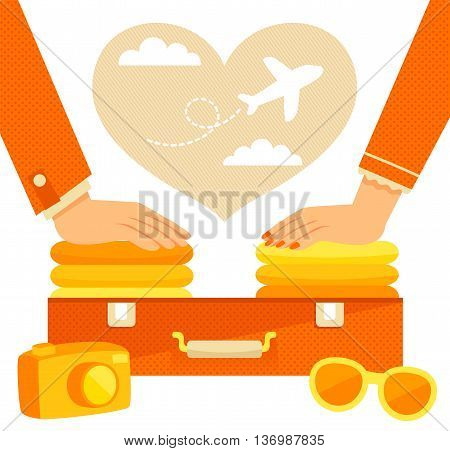 man and woman packing a suitcase for a vacation